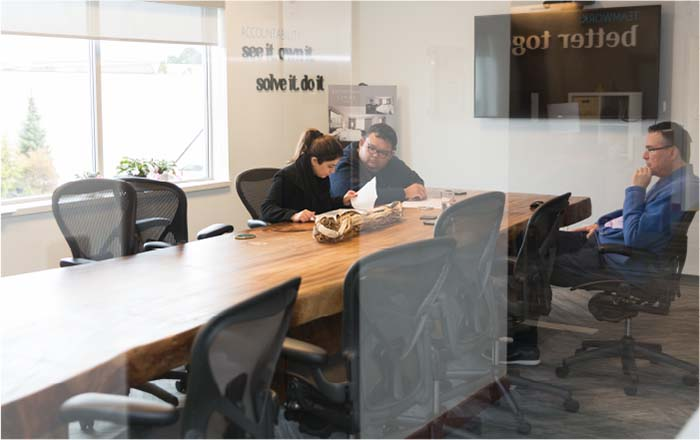 Coworkers discussing a project in a conference room